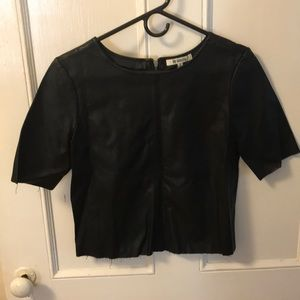 Faux leather top with zipper up back